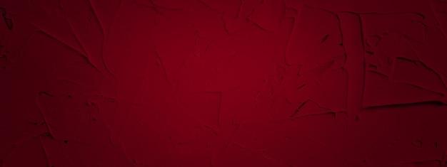 Roter strukturierter hintergrund der füllpaste, die mit spachtel in unregelmäßigen strichen und strichen aufgetragen wird