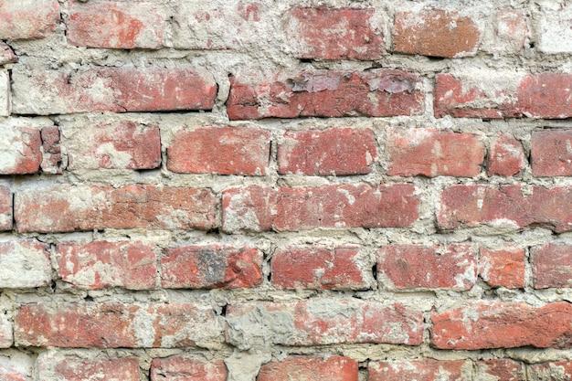 Roter unebener backsteinmauerhintergrund alt. nahaufnahme horizontal