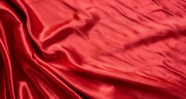 Roter wellengewebemuster abstrakter hintergrund.