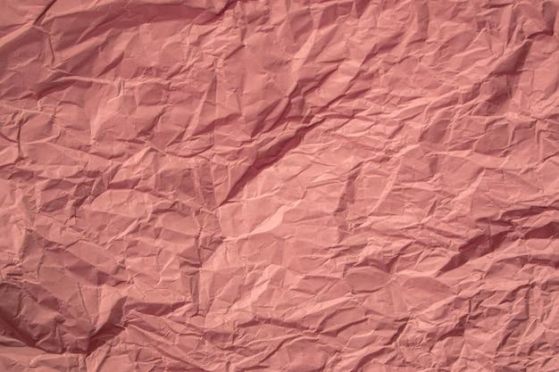 Roter zerknitterter papierabschluß herauf beschaffenheitshintergrund