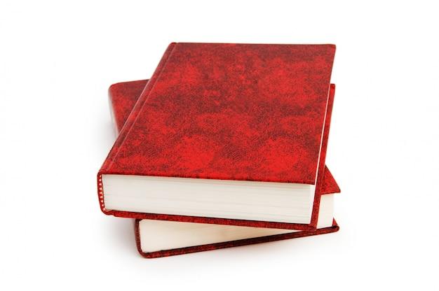 Rotes abdeckungsbuch getrennt auf weiß