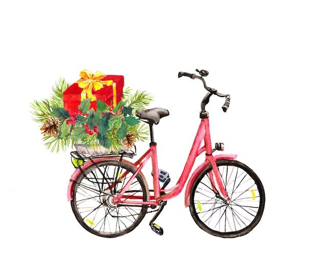 Rotes fahrrad mit gezierten weihnachtsbaumasten, mistelzweig, rote geschenkbox