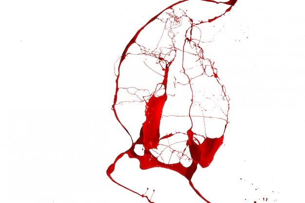 Rotes farbenspritzen lokalisiert auf weißem hintergrund.