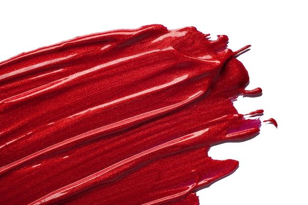 Rotes fleckmuster des lippenstifts lokalisiert auf weißem hintergrund