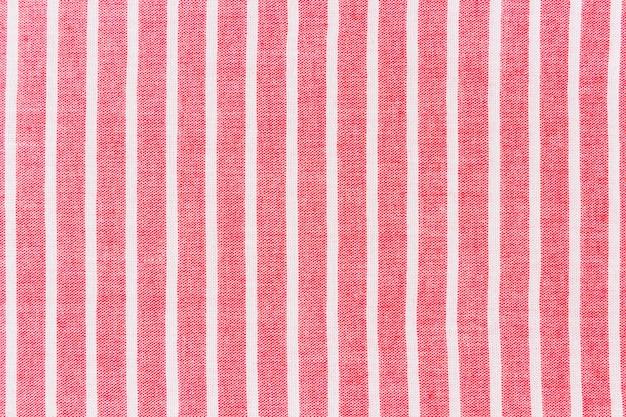 Rotes gewebe mit weißer linie musterhintergrund