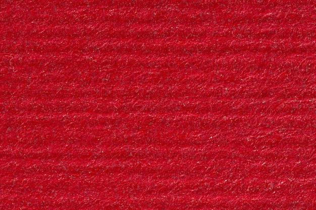 Rotes papier mit horizontalen streifen. hochauflösendes foto.