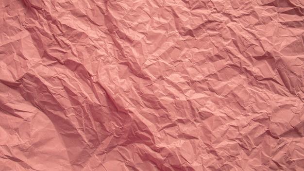 Rotes rosa zerknitterter papierabschluß herauf beschaffenheitshintergrund