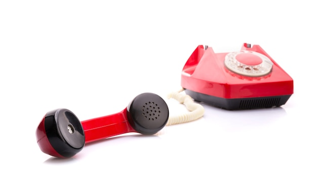 Rotes telefon auf weiß