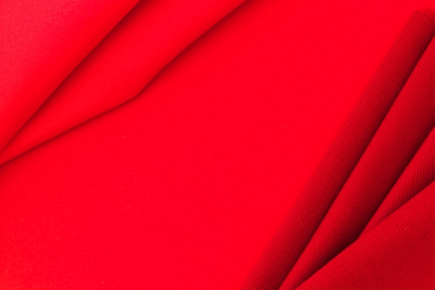 Rotes textilgewebe auf beschaffenheitshintergrund