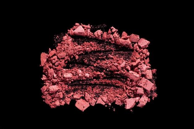 Rouge oder gepresster puder strukturierter schwarzer isolierter hintergrund