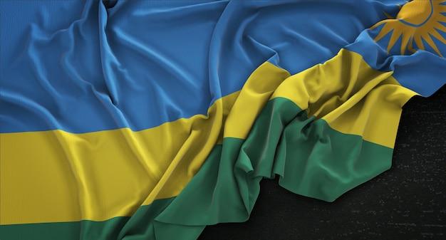 Ruanda-flagge geknickt auf dunklem hintergrund 3d render