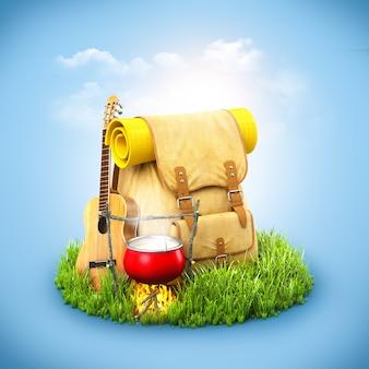 Rucksack mit giutar und lagerfeuer auf gras