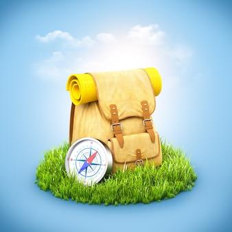Rucksack mit kompass auf gras
