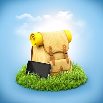 Rucksack mit tablette auf gras