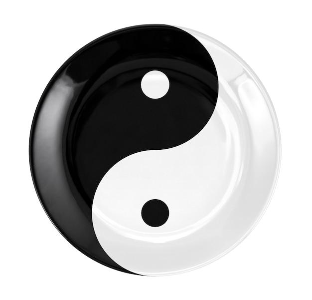 Runde flache platte mit yin- und yang-symbol
