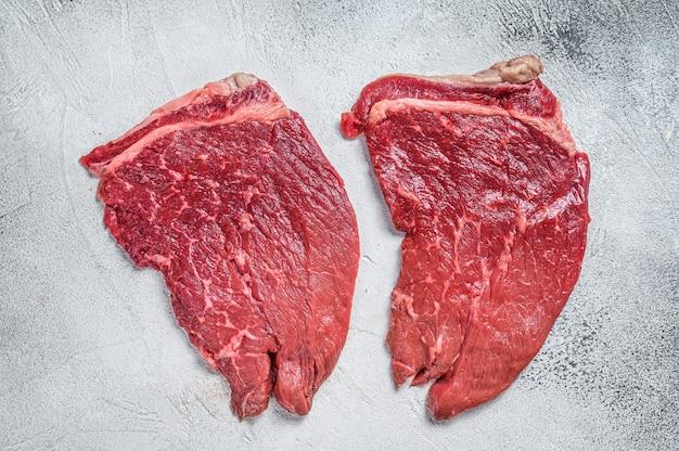 Rundes steak des rohen frischen rindfleisches.