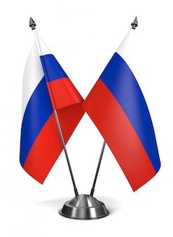 Russische miniaturflaggen auf weiß.