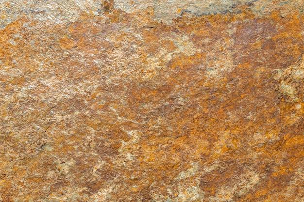 Rustikaler grunge rauer metallischer steinfliesen-textur-hintergrund