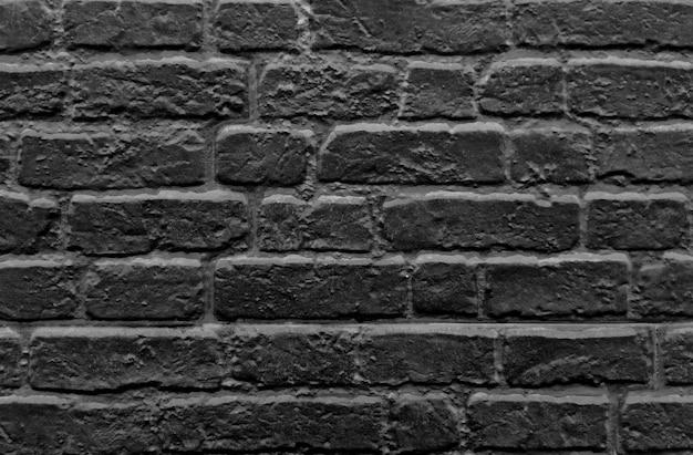 Rustikaler hintergrund der dunklen backsteinmauer