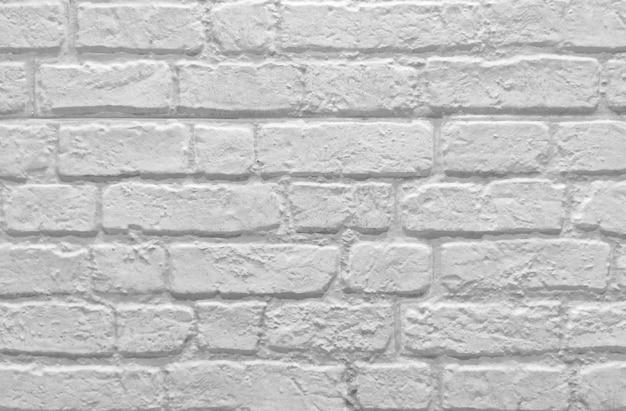 Rustikaler hintergrund der weißen backsteinmauer