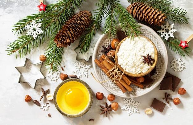 Saisonaler backenwinterhintergrund zutaten für weihnachtsbacken draufsicht flach hintergrund