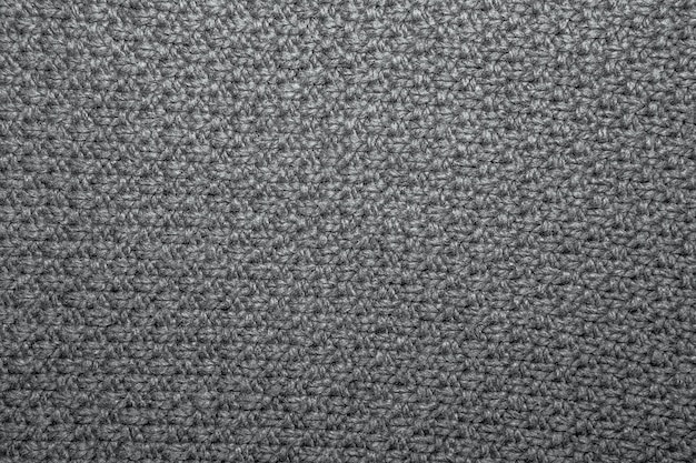 Samenstich in braunem garn als abstrakte hintergrundtextur