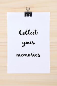 Sammeln sie ihre erinnerungen handgezeichneten schriftzug auf weißem papier