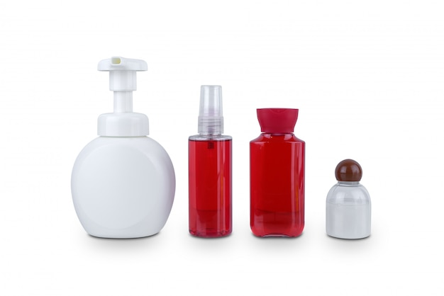Sammlung der plastikflasche der verschiedenen kosmetischen hygienebehälter der schönheit mit der körperbefeuchtung lokalisiert auf weiß