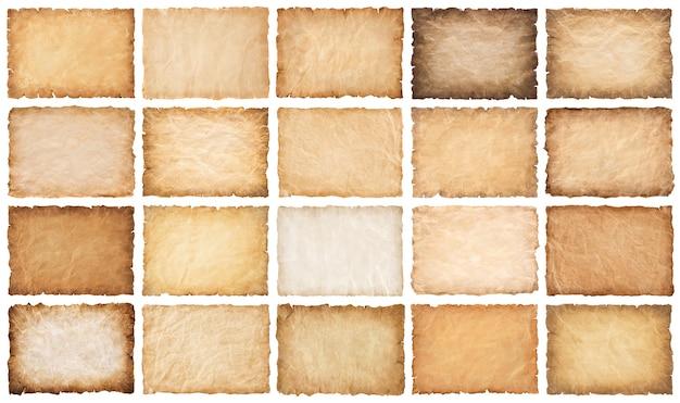 Sammlungssatz alte pergamentpapierblattweinlese gealtert oder beschaffenheit lokalisiert auf weißem hintergrund.