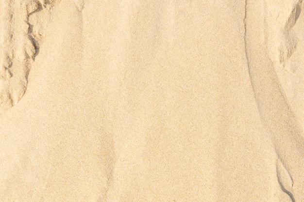 Sand am strand als hintergrund. hellbeige meersand-texturmuster, sandstrand-texturhintergrund.