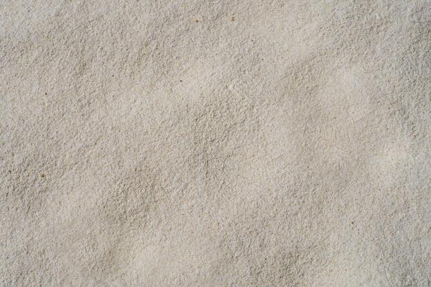 Sandbeschaffenheitshintergrund, natürlicher sand an einem weichen weißen strand