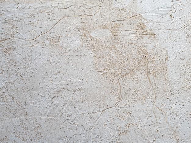 Sandfarbe gemalte textur mit pinsel und spachtelstrichen für interessante und moderne hintergründe. backgound texturkonzept. foto der groben striche der braunbeigen farbe. tapeten- und kopierraum