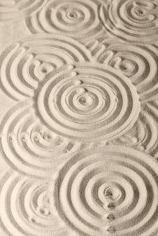 Sandoberflächentextur mit kreisen und schatten