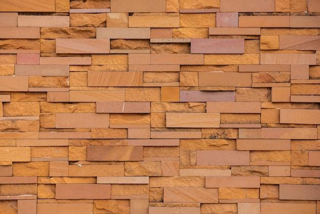 Sandsteinziegelsteine nahtlos von der wand. fortlaufende musterreplikation für textur und hintergrund