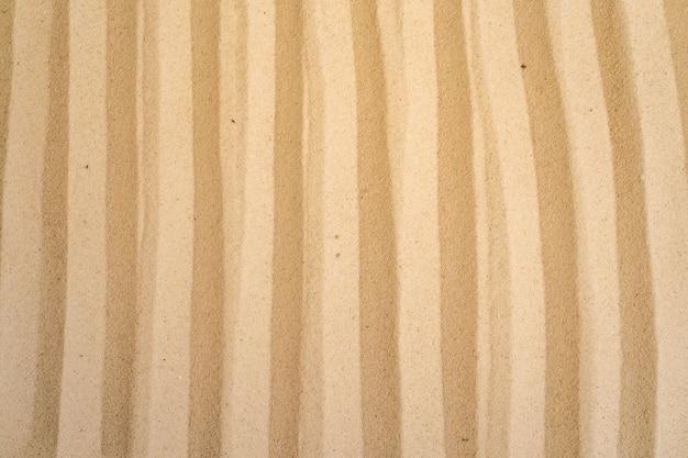 Sandstrandhintergrund und texturmuster mit raum.
