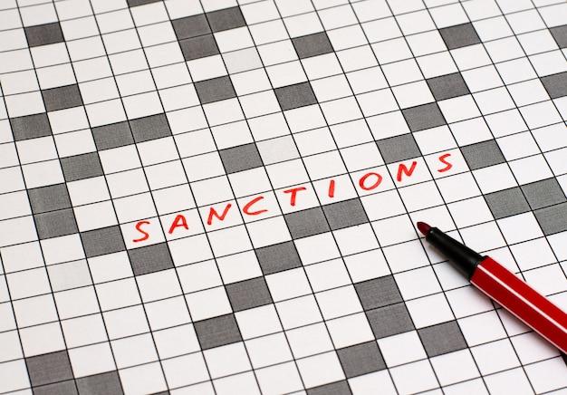 Sanktionen. text in kreuzworträtsel. rote buchstaben