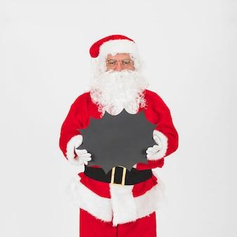 Santa claus, die tafel steht und hält