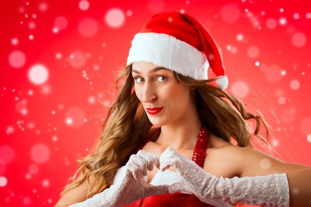 Santa claus-frau, die verlockend ist