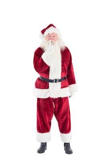 Santa fragt nach ruhe zur kamera