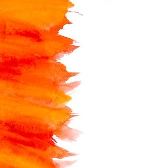 Satz rote und gelbe Aquarellbürstenanschläge auf weißem Hintergrund
