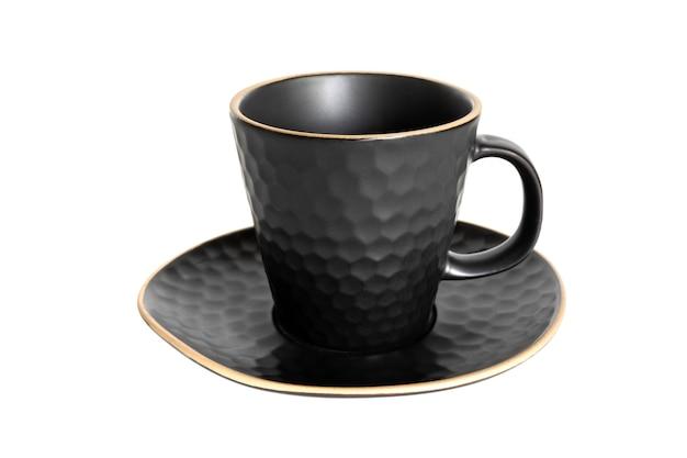 Satz von schwarzen tee tassen und untertassen auf weißem hintergrund keramik kaffeetasse oder tasse nahaufnahme