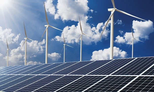 Sauberer energieleistungskonzept sonnenkollektor mit hintergrund der windkraftanlage und des blauen himmels