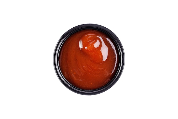 Sauce ketchup in einer einwegschale aus kunststoff auf einem weißen