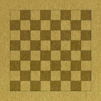 Schachbrett im goldenen papierhintergrund