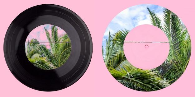 Schallplatte mit palmen. ein abweichendes design einer schallplatte. gemischte medien.