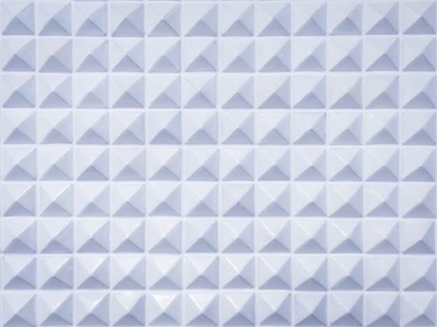 Scharfe pyramidenelemente geometrisch strukturiert. kunststoff scharfer pyramidenhintergrund.