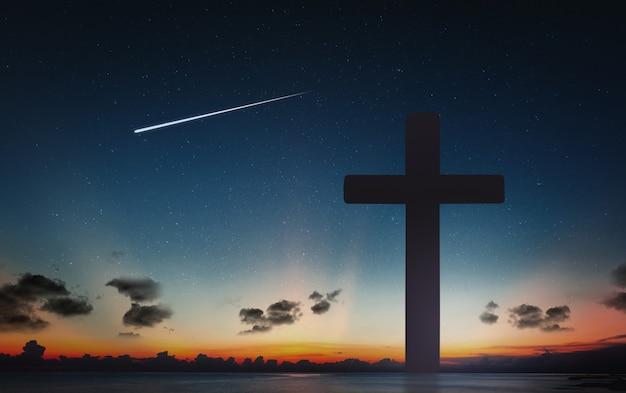 Schattenbild des kruzifixkreuzes zur sonnenuntergangzeit und zum nächtlichen himmel mit sternschnuppenhintergrund.