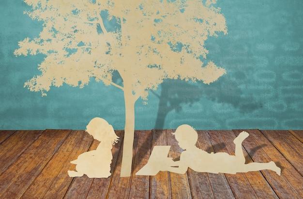 Scherenschnitt von kindern ein buch zu lesen unter baum