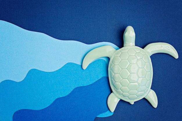 Schildkröte und papier geschnitten für weltmeertag