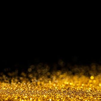 Schillernder goldglitter mit kopierraum